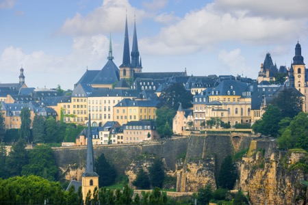 View of Luxembourg Old Town, with the two towers of the Notre Dame Cathedral in the background, and the tower of the abbey church Saint Johann in the foreground